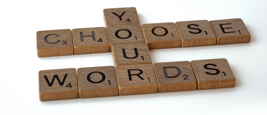 Scrabble tiles that spell 'Choose your words'