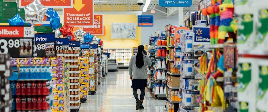 Person in supermarket aisle